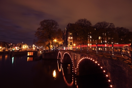 Amsterdam at night in the Netherlands photo