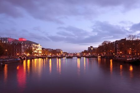 City scenic in Amsterdam innercity in the Netherlands at twilight  photo