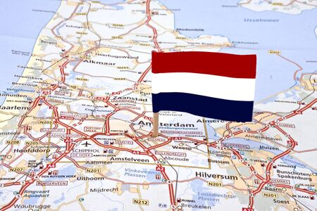 Map from the Netherlands with the dutch flag pointed at the capital Amsterdam  photo