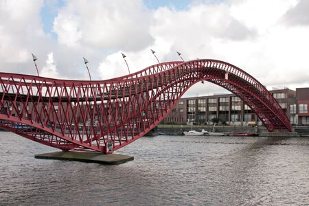 cruiseboat: Pedestrian bridge in Amsterdam innercity in the Netherlands