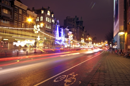 Street life by night in Amsterdam the Netherlands at christmas
