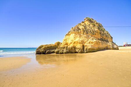 Rocks and ocean at Praia Tres Irmaos in Alvor Algarve Portugal Stock Photo - 12584659