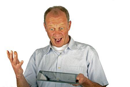 Glücklicher Mann mit seinem iPad Tablet-Computer Standard-Bild - 12778655