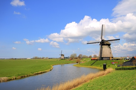 Traditional windmills in dutch landscape in the Netherlands photo