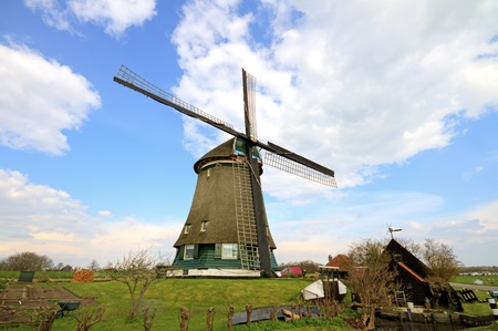 Traditional windmills in dutch landscape in the Netherlands Stock Photo - 13231025