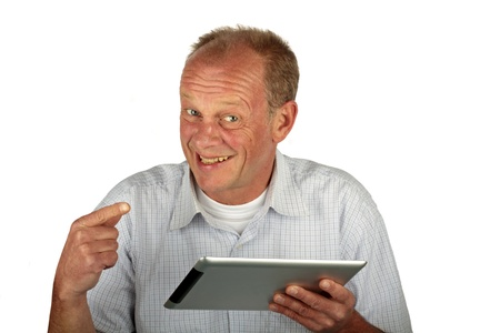 Happy man pointing at his tablet computer on a white background Stock Photo - 13249614