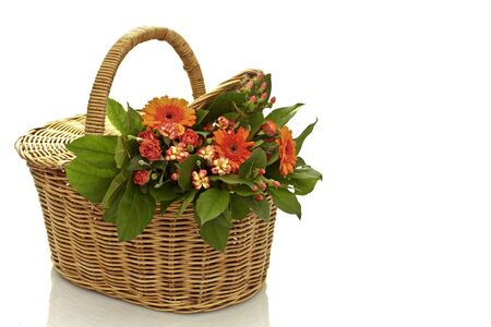 a bouquet of flowers in a wicker basket on a white background photo