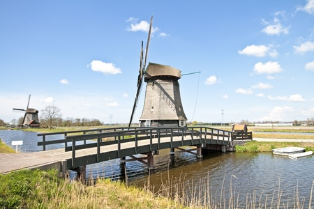 Traditional windmills in dutch landscape in the Netherlands Stock Photo - 13451437