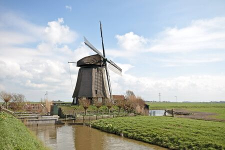 traditional windmill in dutch landscape in the Netherlands Stock Photo - 13451438