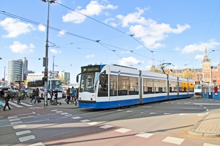 Trams at Central Station in Amsterdam the Netherlands
