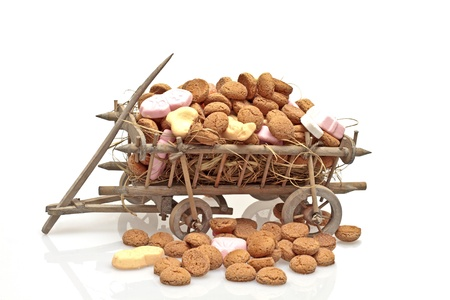 ginger nuts: Old cart full of ginger nuts  for santa claus feast on the 5th of december Stock Photo