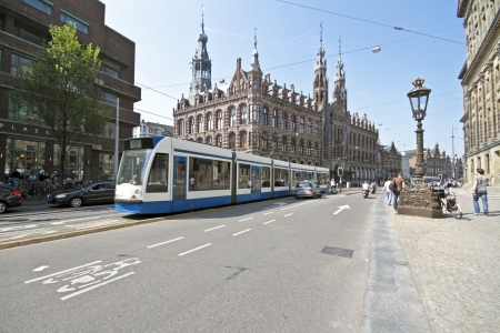 Tram driving in Amsterdam historical center in the Netherlands