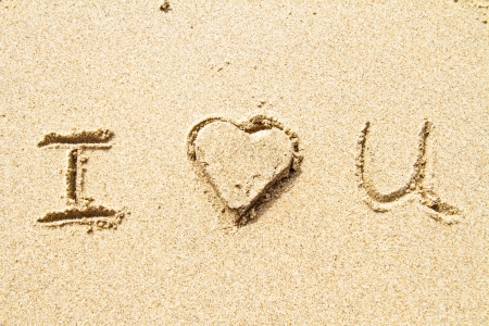 I love you written in sand for natural, love,tourism or conceptual designs Stock Photo