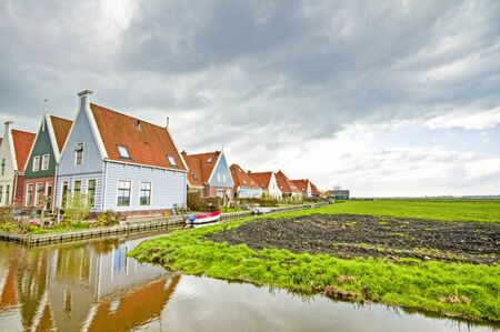 typically dutch: Typically dutch  Houses along canals in the countryside from the Netherlands