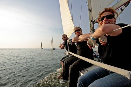 Sailing on the IJsselmeer at Pampus in the Netherlands with sunset Stock Photo