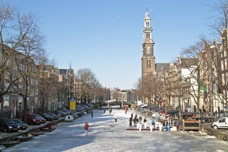 amsterdam canal: Winter at the Prinsengracht with the Westerkerk in Amsterdam the Netherlands