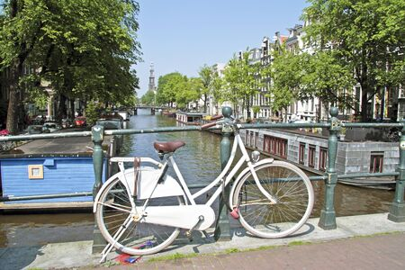 westerkerk: White bicycle in Amsterdam with the Westerkerk in the Netherlands