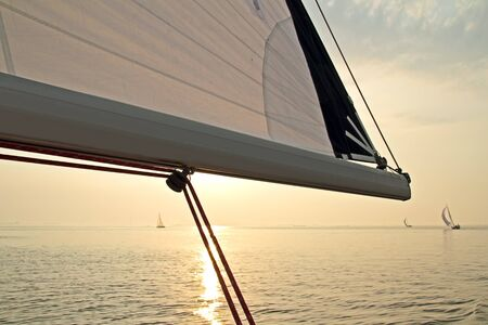 ijsselmeer: Sailing on the IJsselmeer at sunset in the Netherlands Stock Photo