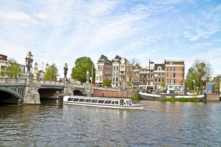 cruiseboat: Sightseeing in Amsterdam the Netherlands on the river Amstel