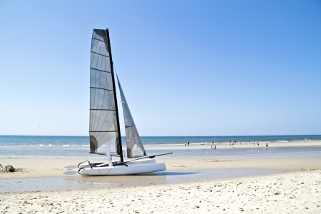skiff: Catamaran at the beach from the north sea in the Netherlands