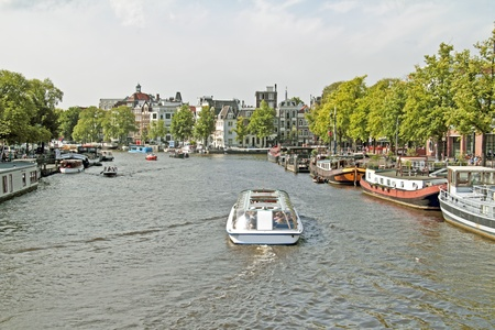 Sightseeing on the river Amstel in Amsterdam in the Netherlands Editorial