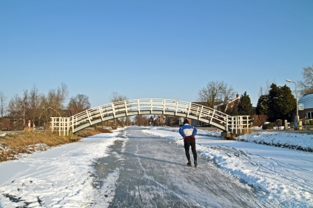typically dutch: Ice skating in the countryside from the Netherlands