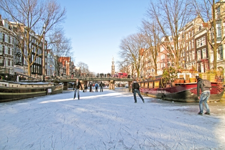 ice skating: Ice skating on the canals in Amsterdam the Netherlands in winter