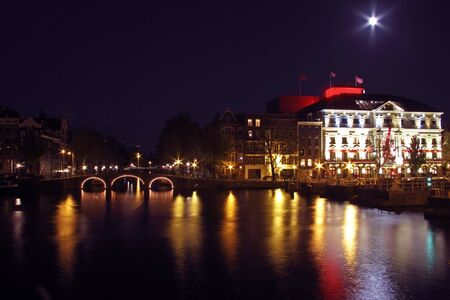 amstel river: City scenic from Amsterdam by night in the Netherlands