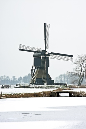 Snowy traditional windmill in the countryside from the Netherlands Stock Photo - 16822961