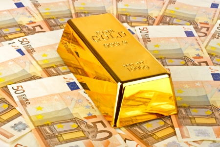 Gold bar and euro money photo