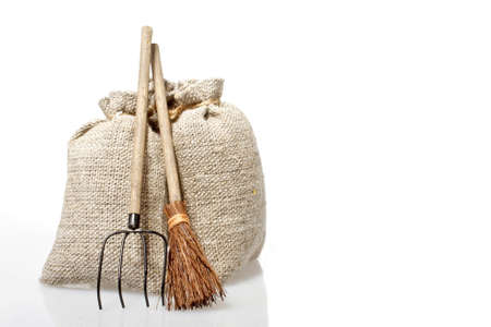agricultural tools: Bags with potatoes and agricultural tools on a white background