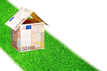 Euro money house on a road from grass Stock Photo - 17715110