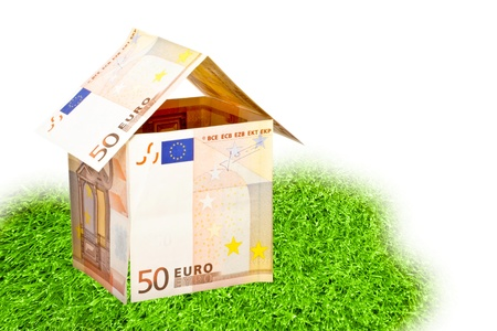 euro money house on a piece of grass Stock Photo - 17714882