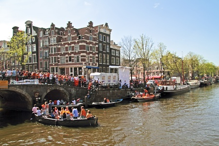 cruiseboat: AMSTERDAM - APRIL 30  Celebration of queensday on April 30, 2012 in Amsterdam, The Netherlands