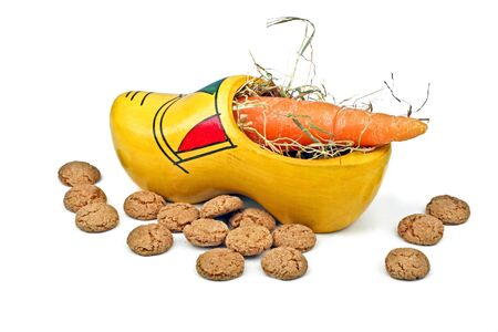 Wooden clog with straw, gingernuts and carrot for 5 december santa claus feast in the Netherlands Stock Photo - 17996919