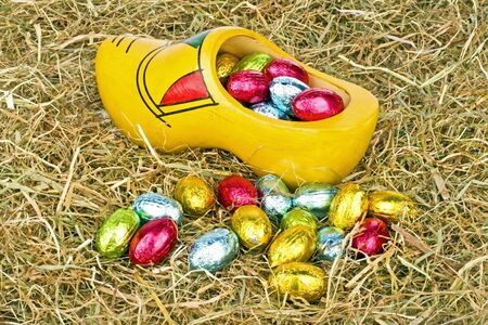 Traditional dutch wooden clog with little colored eggs Stock Photo - 18232000