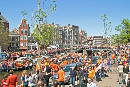 cruiseboat: AMSTERDAM - APRIL 30: Celebration of queensday on April 30, 2012 in Amsterdam, The Netherlands