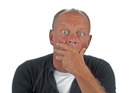 stupor: Astonished looking man on a white background