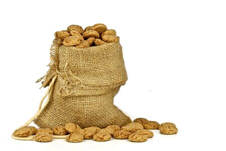 Jute bag full of gingerbread nuts on a white background Stock Photo - 18867910