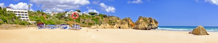 tres: Panorama from rocks and ocean at Praia Tres Irmaos in Alvor Portugal Editorial