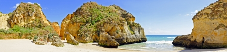 tres: Panorama from rocks and ocean at Praia Tres Irmaos in Alvor Portugal Stock Photo