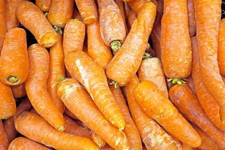 carots: Organic carots in a market stall Stock Photo