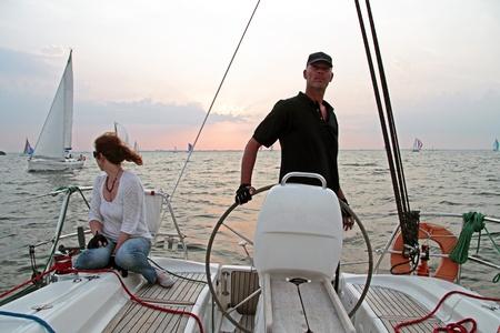 ijsselmeer: Sailing on the IJsselmeer in the Netherlands at sunset