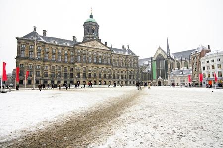 dam square: Snowy Damsquare in Amsterdam the Netherlands in winter Editorial