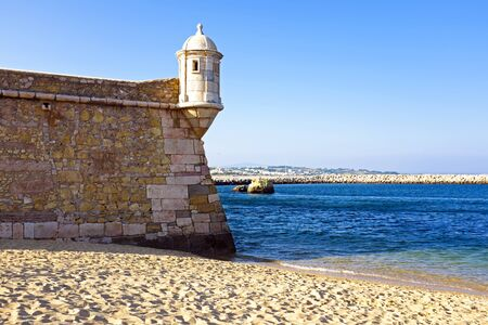 region of algarve: Medieval tower from Fortaleza da Ponta da Bandeira at Lagos Stock Photo