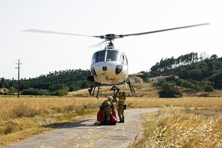 ALJEZUR - JULY 6  Firefighters fighting a huge bushfire in the national park near Aljezur on 6th july 2013 in Portugal