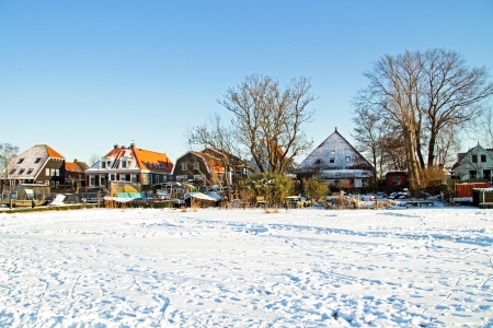 Snowy traditional dutch houses in the Netherlands in winter Stock Photo - 21490747