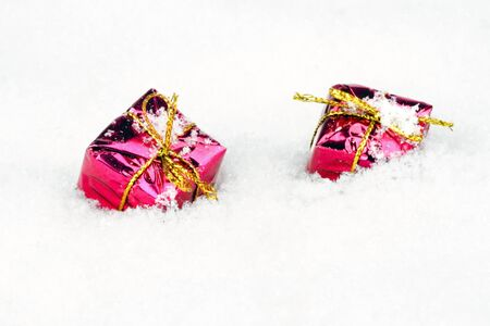 Christmas gifts in the snow Stock Photo - 21490895