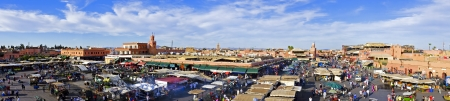 Djemaa el Fna market in Marrakesh, Morocco, with Koutubia Mosque at the back Editorial