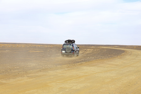 erg: Car driving in the Erg Chebbi desert in Morocco Africa